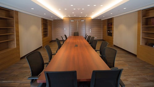 The federal building boardroom prior to moving furniture in to make it a new Premier's office workspace.