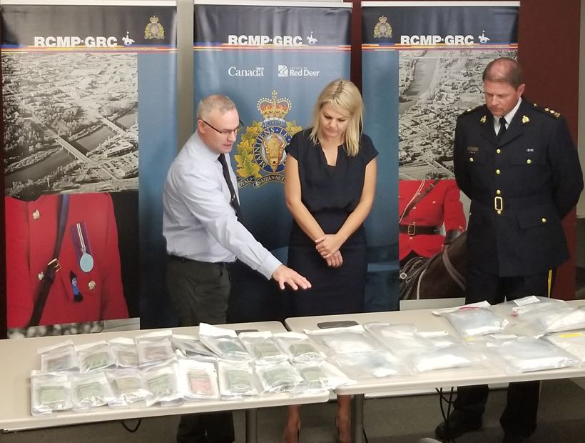 Mayor and RCMP Inspector with evidence
