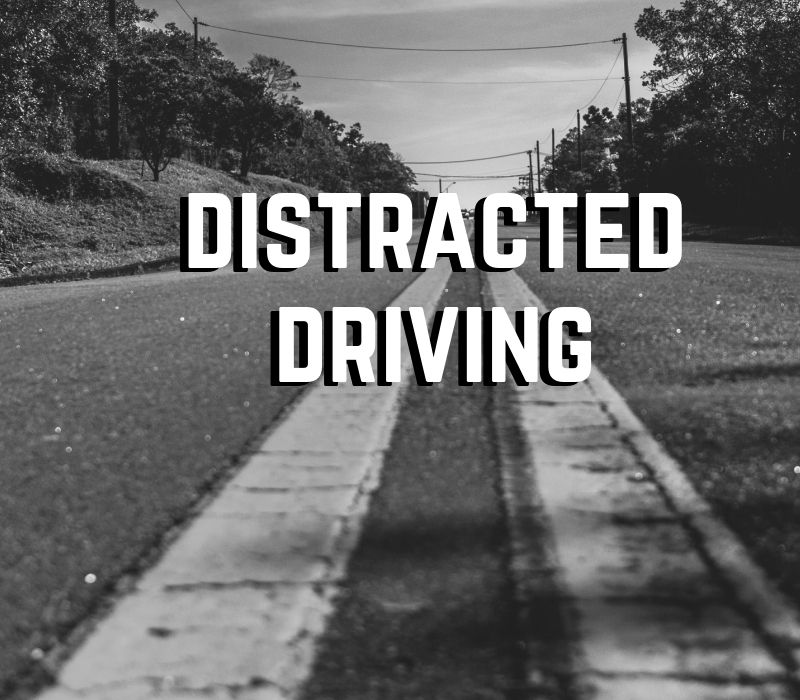 """highway with text """"Distracted Driving"""""""