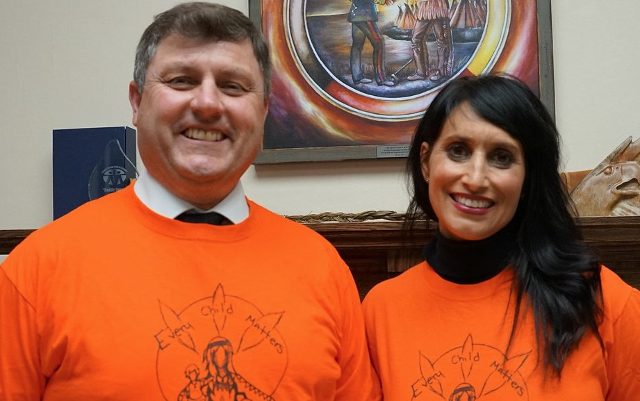 Rick Wilson and Leela Aheer in orange shirts