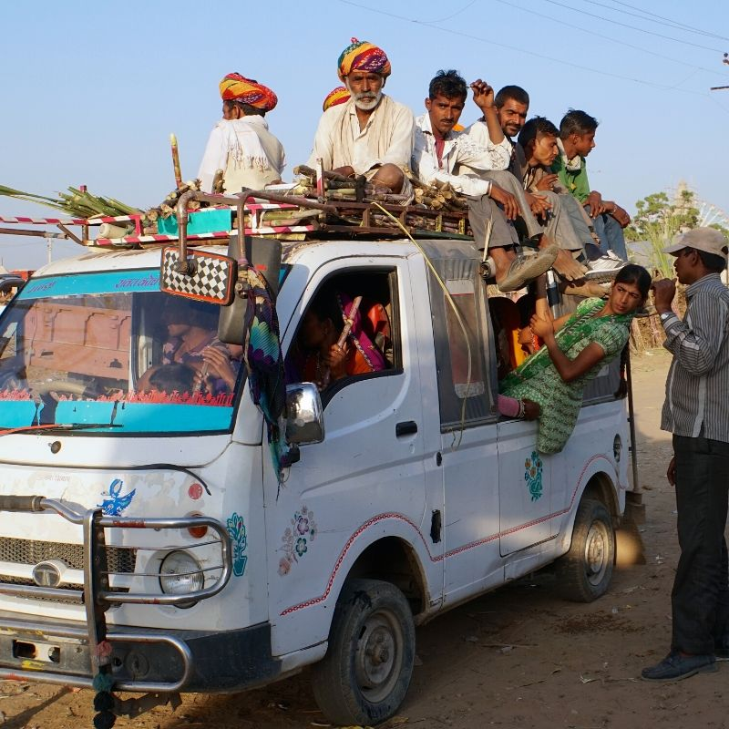 full bus carrying men