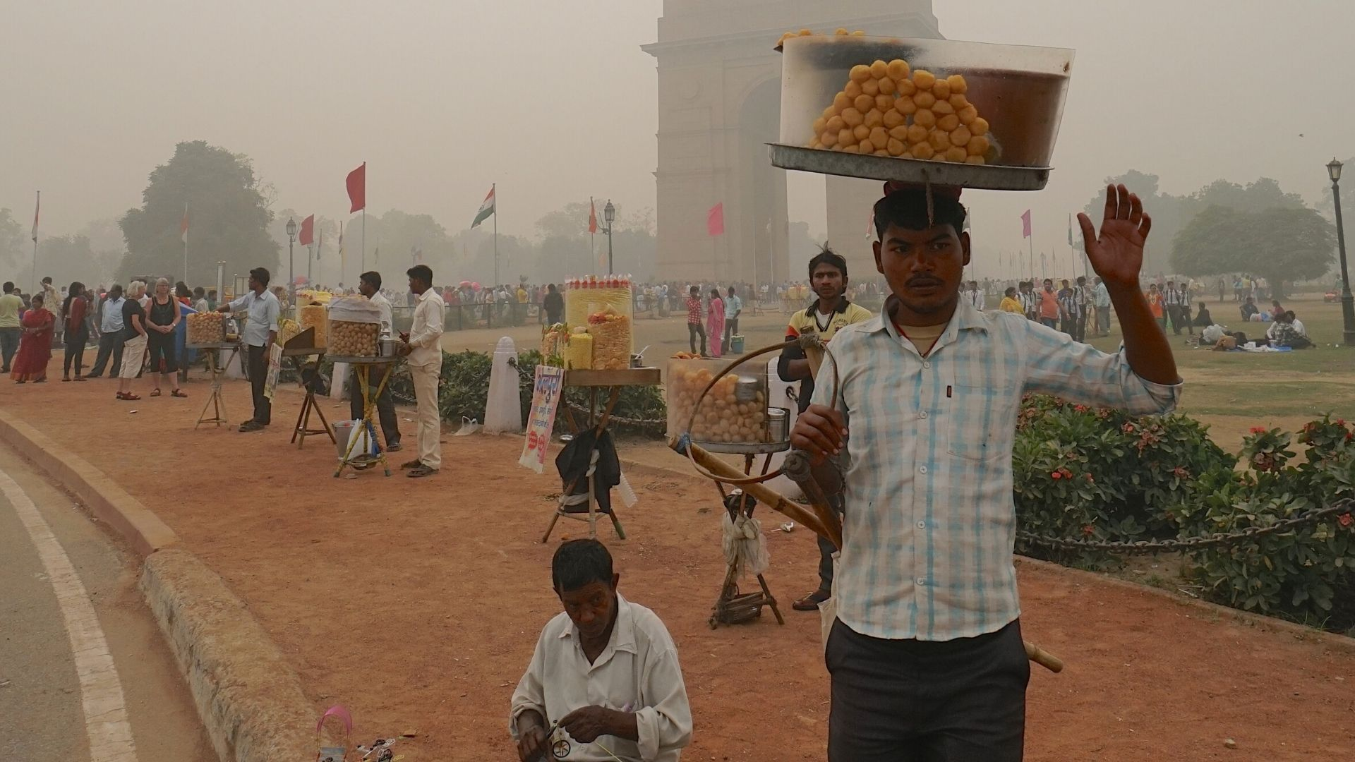Man carrying basket on head