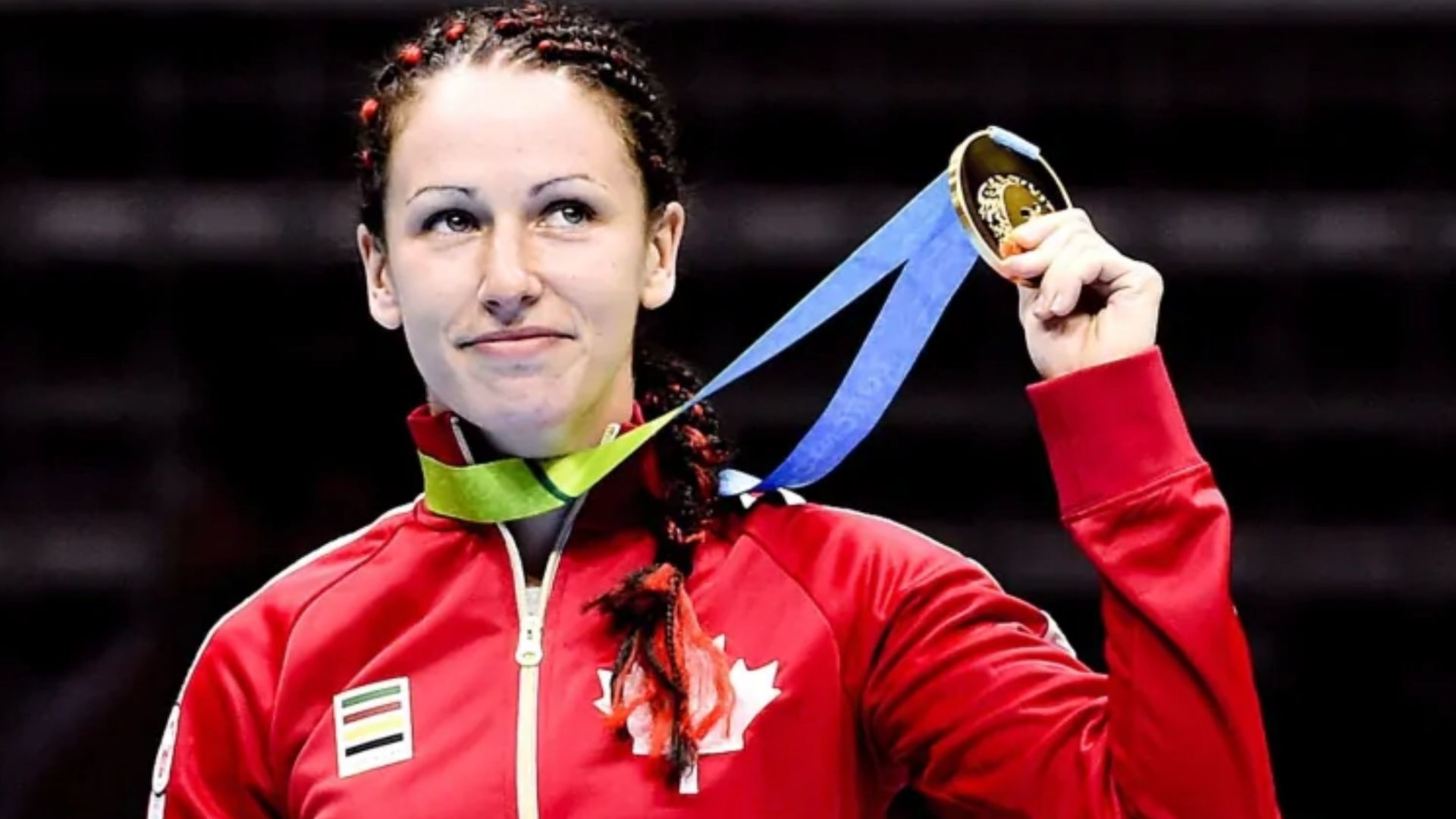 Dionne with Medal